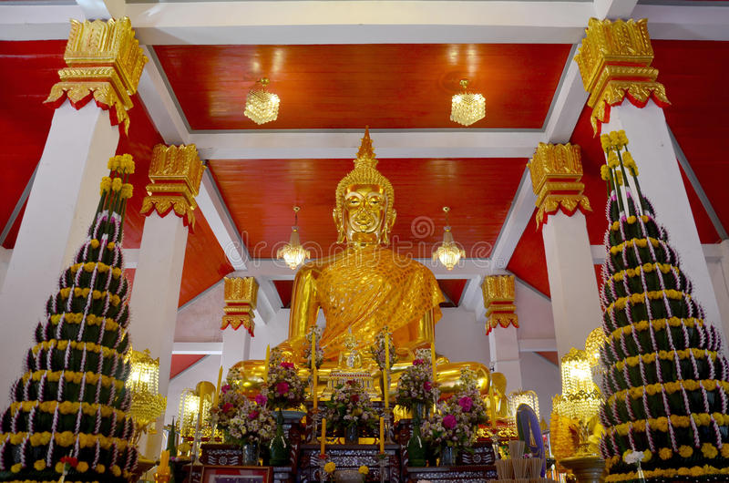 Golden buddha image statue of Phra That Choeng Chum temple. Golden buddha image statue in church thai called Ubosot or bot of Phra That Choeng Chum temple for royalty free stock image