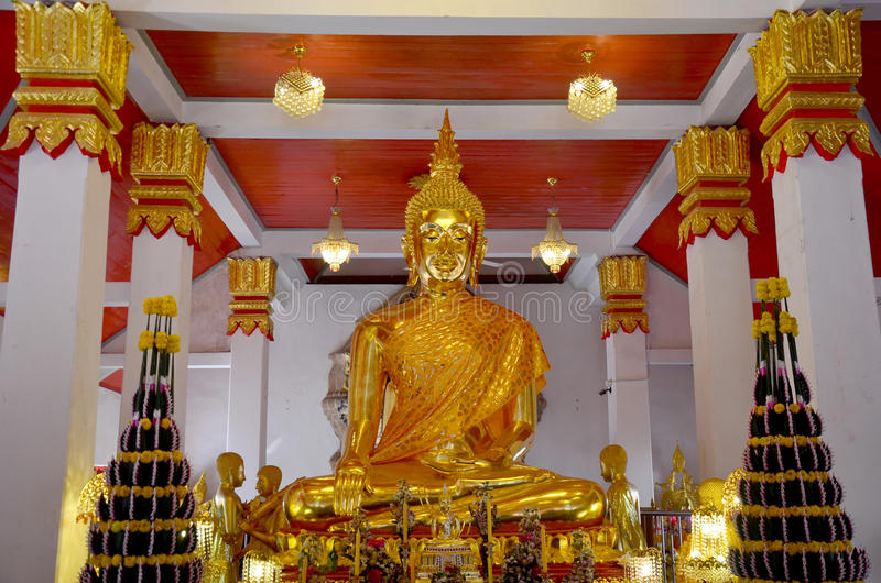 Golden buddha image statue of Phra That Choeng Chum temple. Golden buddha image statue in church thai called Ubosot or bot of Phra That Choeng Chum temple for stock images