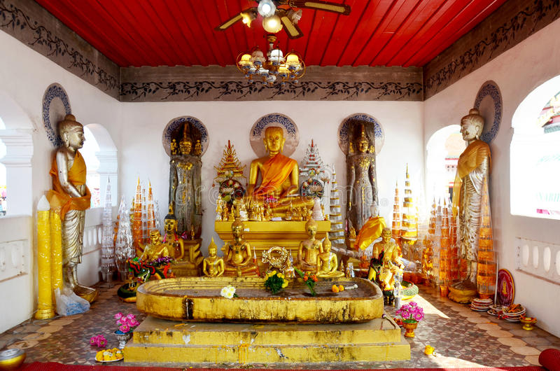 Golden buddha image statue of Phra That Choeng Chum temple. Golden buddha image statue in church thai called Ubosot or bot of Phra That Choeng Chum temple for royalty free stock photography