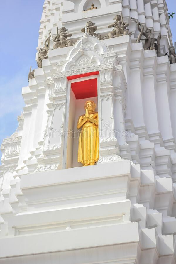 Golden Buddha image on a white pagoda at Wat Arun royalty free stock photography