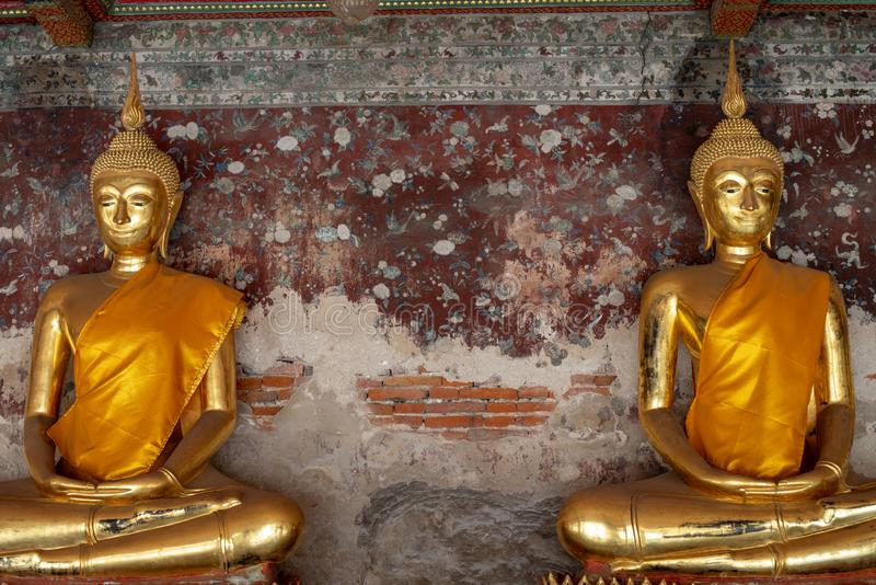 Golden Buddha images in Wat Suthat Thepphawararam the royal temple of the first grade in Bangkok. Construction of the temple was completed in 1847. Bangkok stock photo