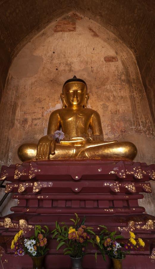 Golden Buddha inside one of pagoda ruins at Bagan, Myanmar (Burma) royalty free stock photo