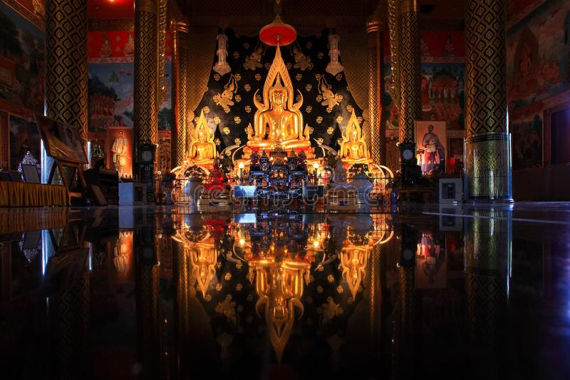 Golden buddha reflection on ground. In temple location at Loei province north east of Thailand royalty free stock image