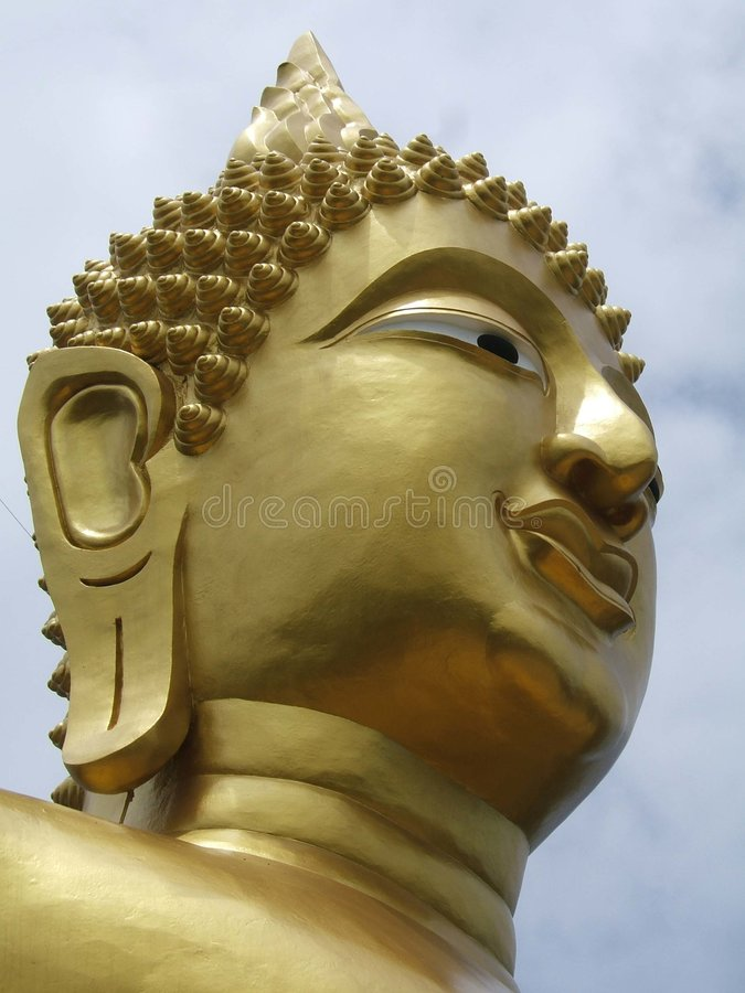 Golden Buddha's face royalty free stock images