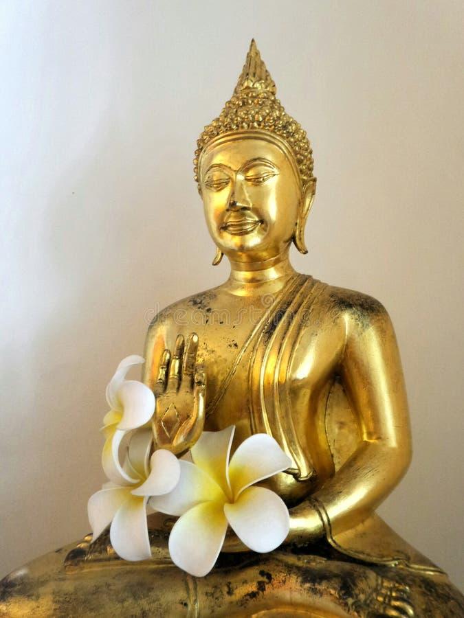 Golden Buddha sculpture on altar stock images