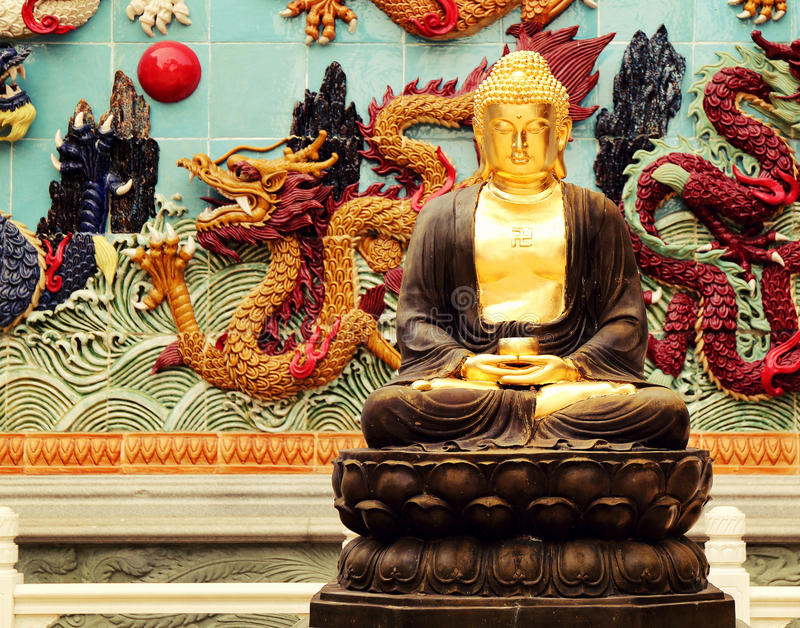 Buddha statue in Asian Chinese buddhist temple. Buddha statue in Chinese temple, China Asia. East Asian traditional golden Gautama buddha statue in Asian temple royalty free stock photo