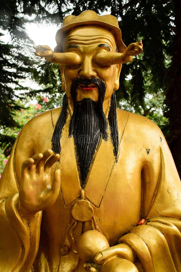 Golden Buddha statue with hands in the eyes in Ten thousand Buddhas Monastery in Hong Kong, China stock photos