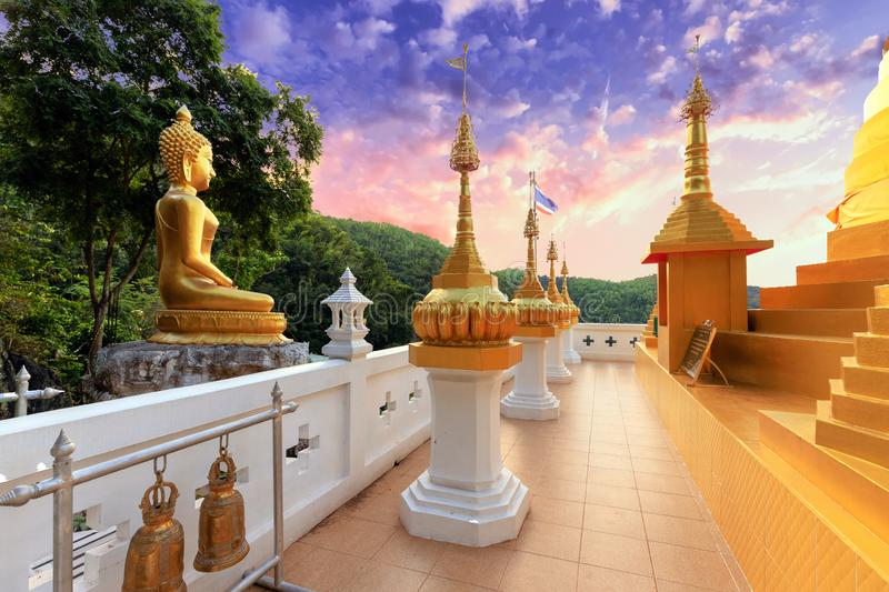 Golden Buddha statue and pagoda royalty free stock photos
