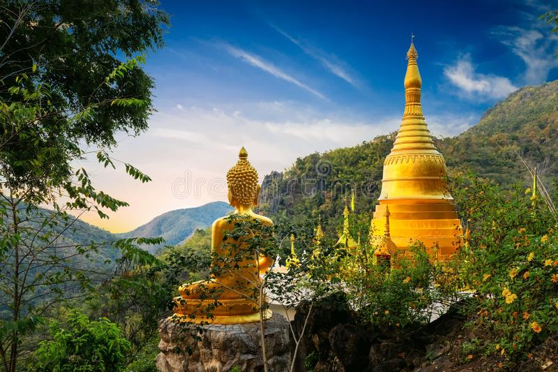 Golden Buddha statue view point stock images