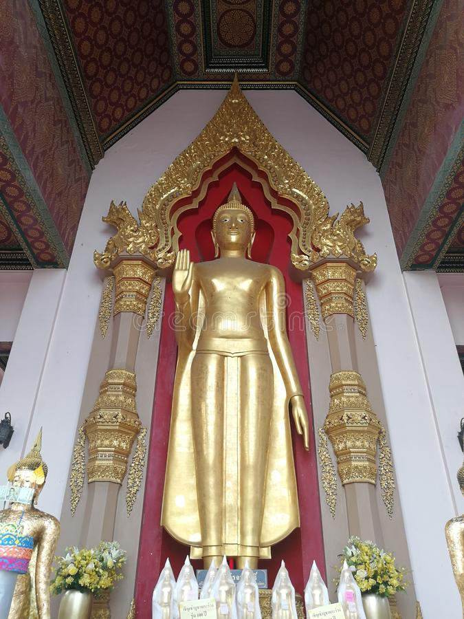 Golden Buddha statue standing large royalty free stock photo