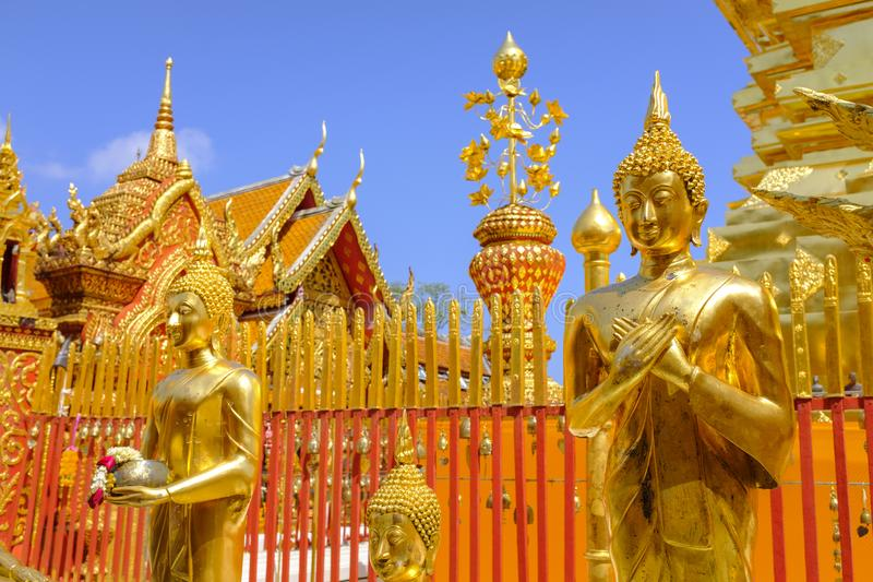 Golden Buddha statue at a temple. Golden Buddha statue at the Wat Phra Doi Suthep Buddhist temple in Chiang Mai, Thailand stock photo