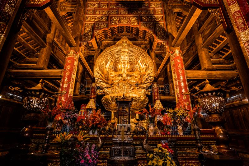 Golden Buddha statue in a temple in northern Vietnam stock image