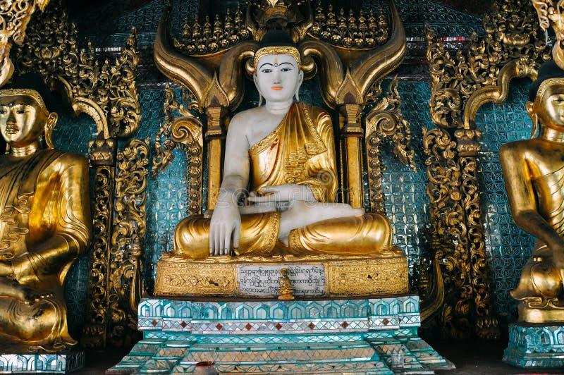 Golden Buddha statue in temple at Shwedagon Pagoda in Yangon. stock photo