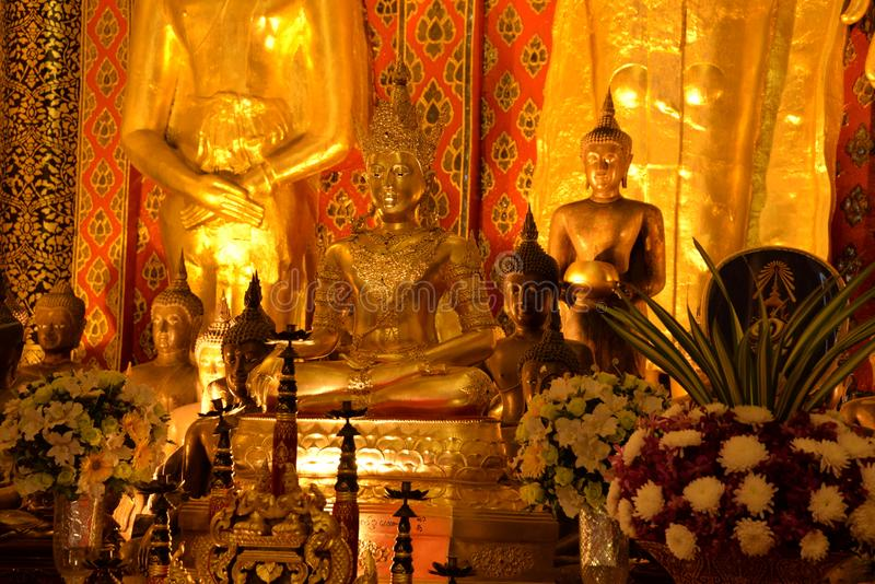 Golden Buddha statue in a Thai Buddhist temple royalty free stock photography