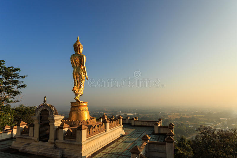 Golden buddha statue in Thai temple, Wat Phra That Khao Noi in N stock photography