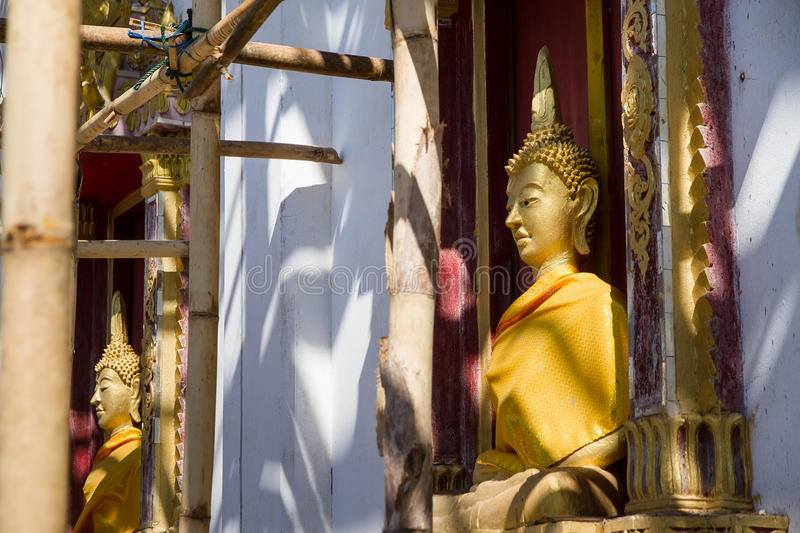 Download Golden Buddha Statue In Under Construction Temple At Wat Somdej Stock Photo - Image: 83703059