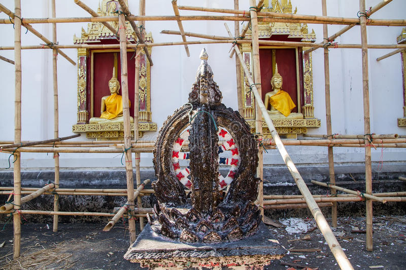 Download Golden Buddha Statue In Under Construction Temple At Wat Somdej Stock Photo - Image: 83703554