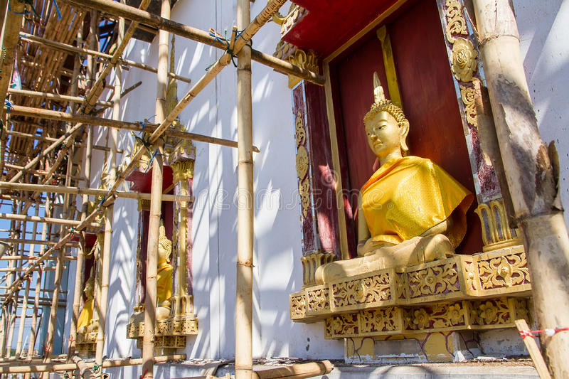 Download Golden Buddha Statue In Under Construction Temple At Wat Somdej Stock Photo - Image: 83704148