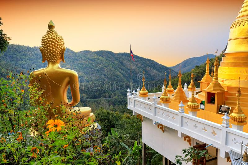 Golden Buddha statue view point stock photography
