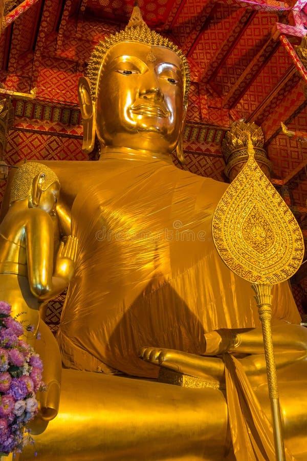 Golden Buddha statue in Wat Phanan Choeng temple. Ayutthaya Historical Park, Thailand. UNESCO World Heritage Site. Golden Buddha statue in Wat Phanan Choeng royalty free stock photography