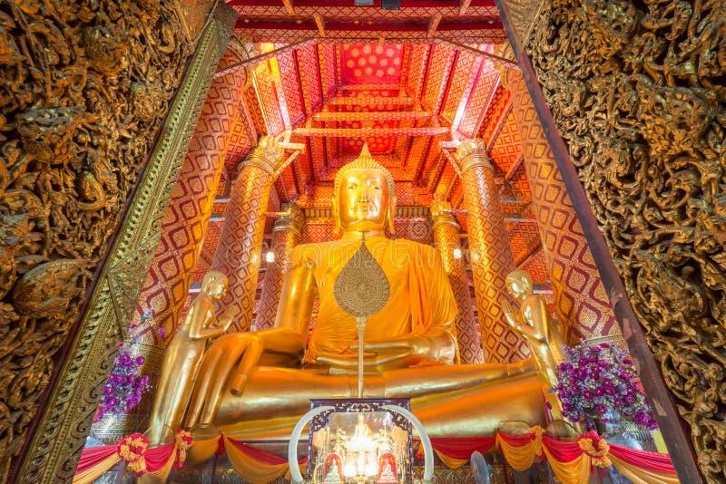 Golden Buddha Statue at Wat Phanan Choeng temple. Golden color The Buddha Statue in the ubosot at Wat Phanan Choeng temple, Ayutthaya, Thailand, World Heritage royalty free stock photography