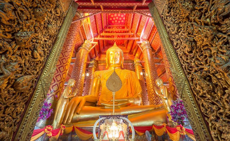 Golden Buddha Statue at Wat Phanan Choeng temple. Golden color The Buddha Statue in the ubosot at Wat Phanan Choeng temple, Ayutthaya, Thailand, World Heritage royalty free stock photo