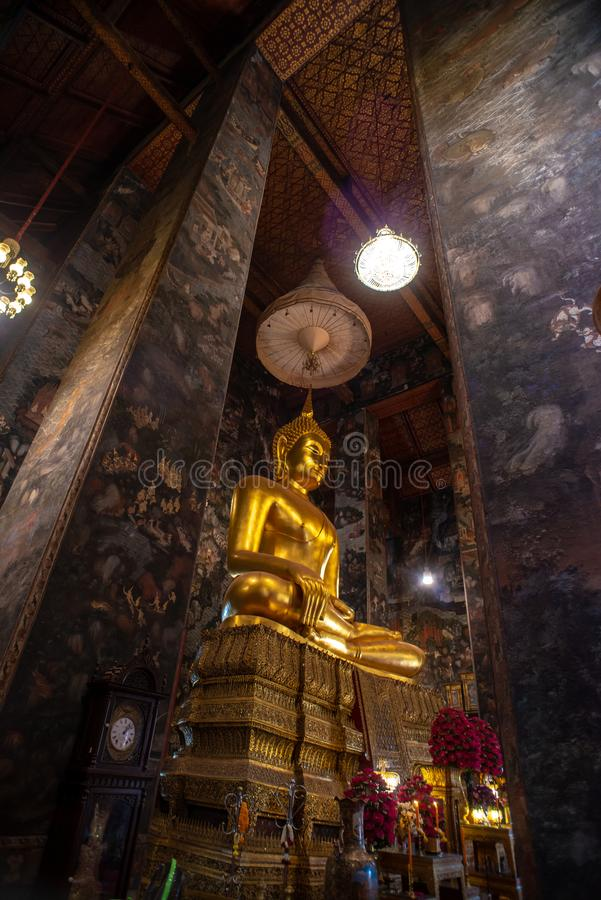 Golden Buddha statue in Wat Suthat Thepphawararam the royal temple of the first grade in Bangkok. Construction of the temple was completed in 1847. Bangkok stock photo