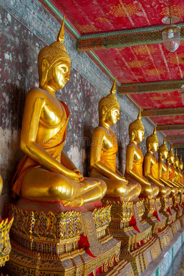 Golden Buddha statue in Wat Suthat Thepphawararam the royal temple of the first grade in Bangkok. Construction of the temple was completed in 1847. Bangkok stock photography