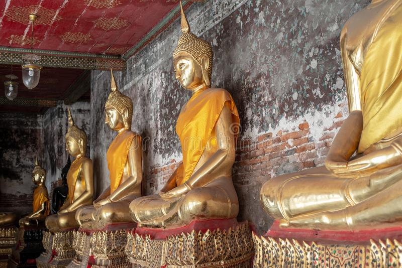 Golden Buddha statue in Wat Suthat Thepphawararam the royal temple of the first grade in Bangkok. Construction of the temple was completed in 1847. Bangkok royalty free stock photos