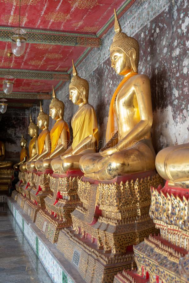 Golden Buddha statue in Wat Suthat Thepphawararam the royal temple of the first grade in Bangkok. Construction of the temple was completed in 1847. Bangkok stock image