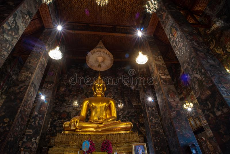 Golden Buddha statue in Wat Suthat Thepphawararam the royal temple of the first grade in Bangkok. Construction of the temple was completed in 1847. Bangkok royalty free stock photography