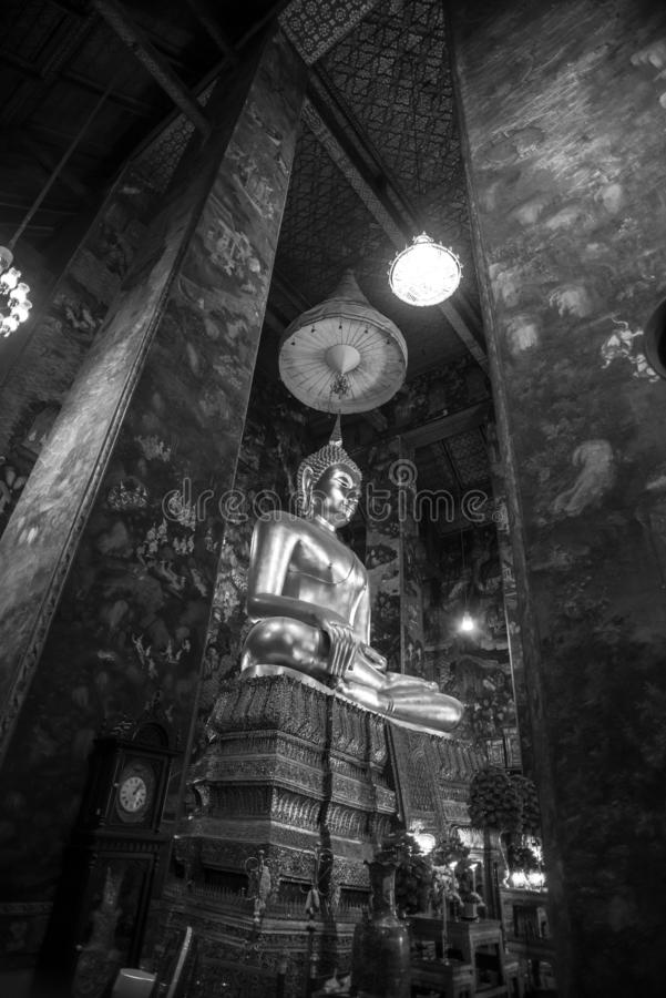 Golden Buddha statue in Wat Suthat Thepphawararam the royal temple of the first grade in Bangkok. Construction of the temple was completed in 1847. Bangkok royalty free stock photo