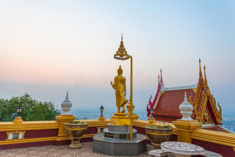 Golden buddha statues on the high mountain. In Kiriwong temple royalty free stock photography