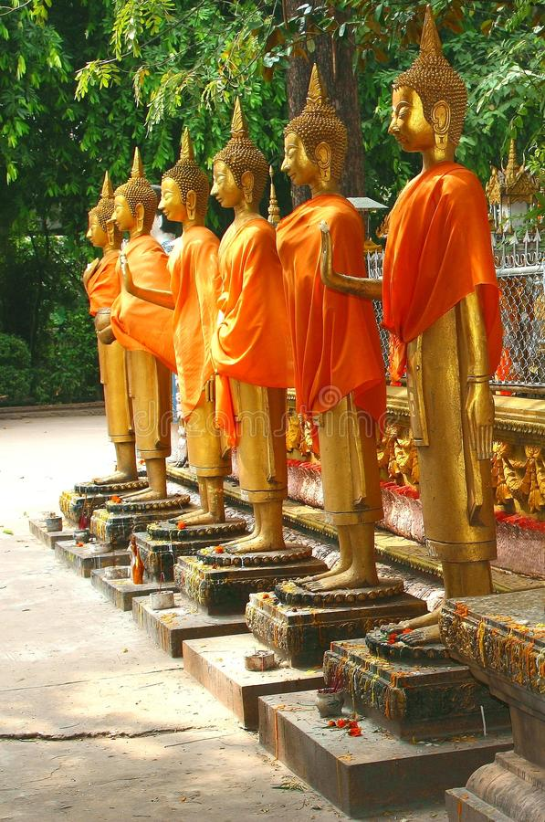 Golden Buddha statues in a temple, Vientiane Laos. Golden Buddha statues in a Buddhist temple in Vientiane in Laos stock photography