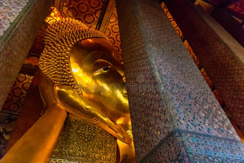 Golden Buddha stature, Phra Kaew temple in bangkok Thailand. Decoration image contain certain grain noise and soft focus stock photography
