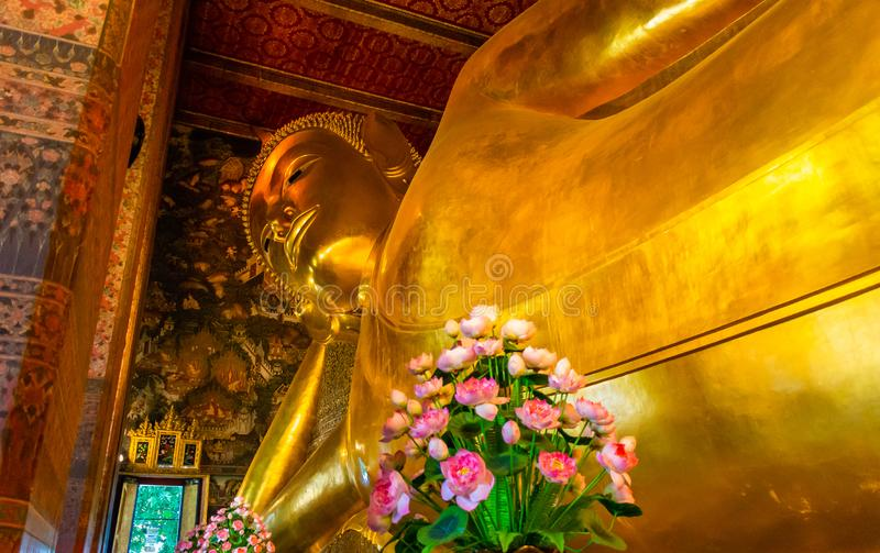 Golden Buddha stature, Phra Kaew temple in bangkok Thailand. Decoration image contain certain grain noise and soft focus royalty free stock photography