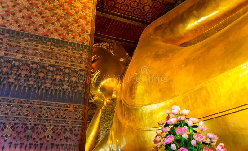 Golden Buddha stature, Phra Kaew temple in bangkok Thailand. Decoration image contain certain grain noise and soft focus royalty free stock photos