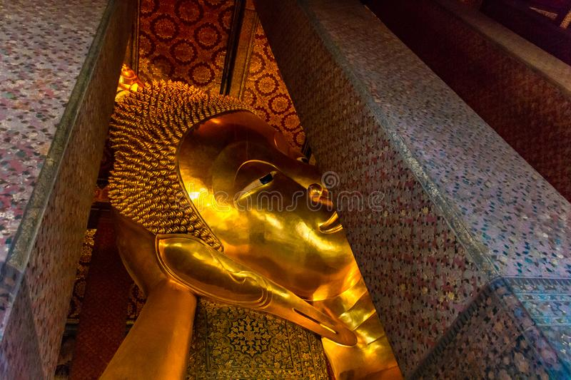 Golden Buddha stature, Phra Kaew temple in bangkok Thailand. Decoration image contain certain grain noise and soft focus stock image