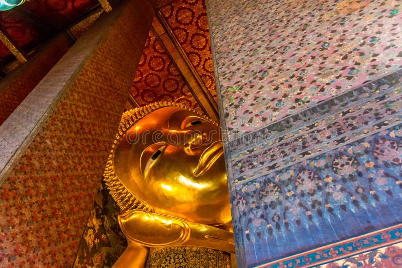 Golden Buddha stature, Phra Kaew temple in bangkok Thailand. Decoration image contain certain grain noise and soft focus stock photo