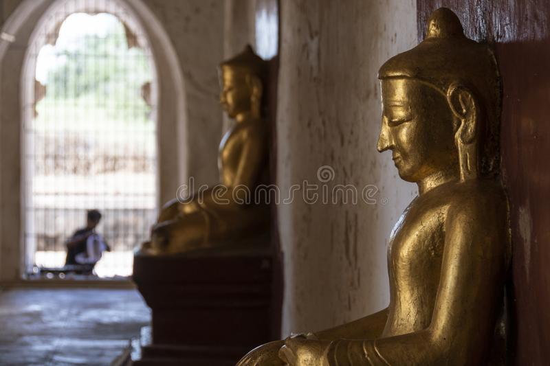 Golden buddha in a temple, Bagan stock photo