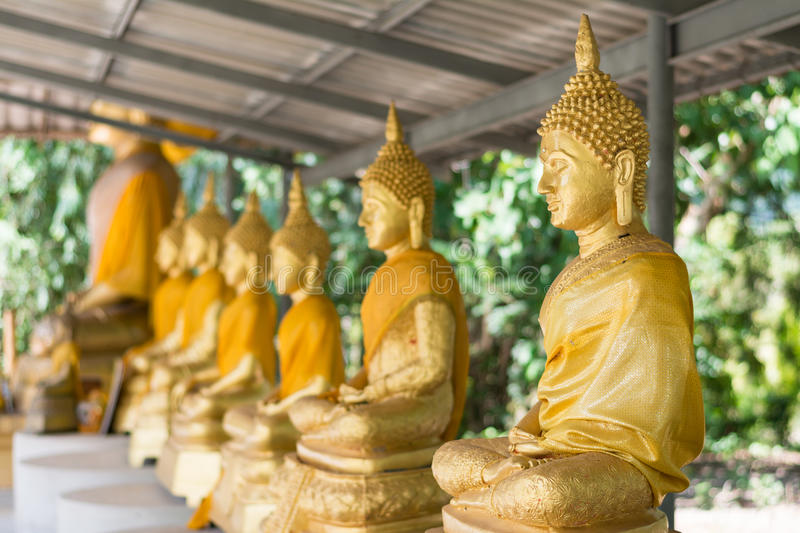 Golden Buddha in the temple royalty free stock images