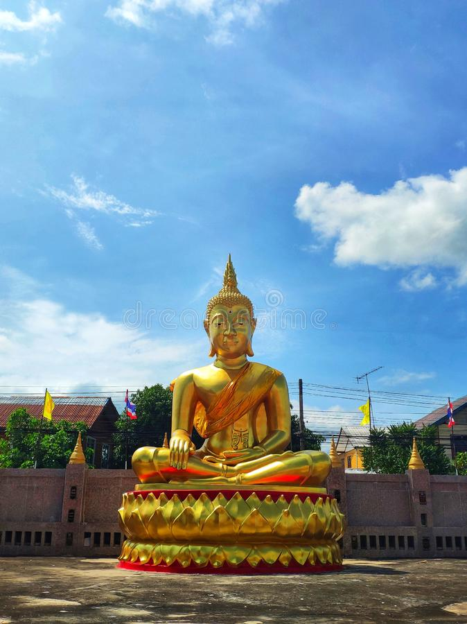 Golden Buddha, in Thailand temple, sky and clouds background stock photos