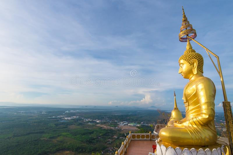 The golden Buddha at the top of mountain, Tiger Cave temple, Krabi, Thailand. The golden Buddha at the top of mountain, Tiger Cave temple, Krabi, Thailand royalty free stock images