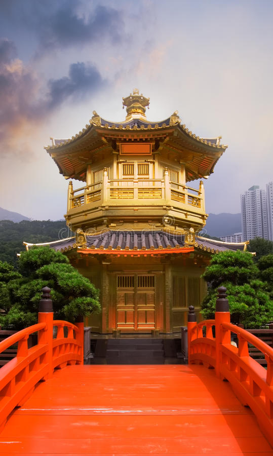 Golden buddhism tower with red bridge