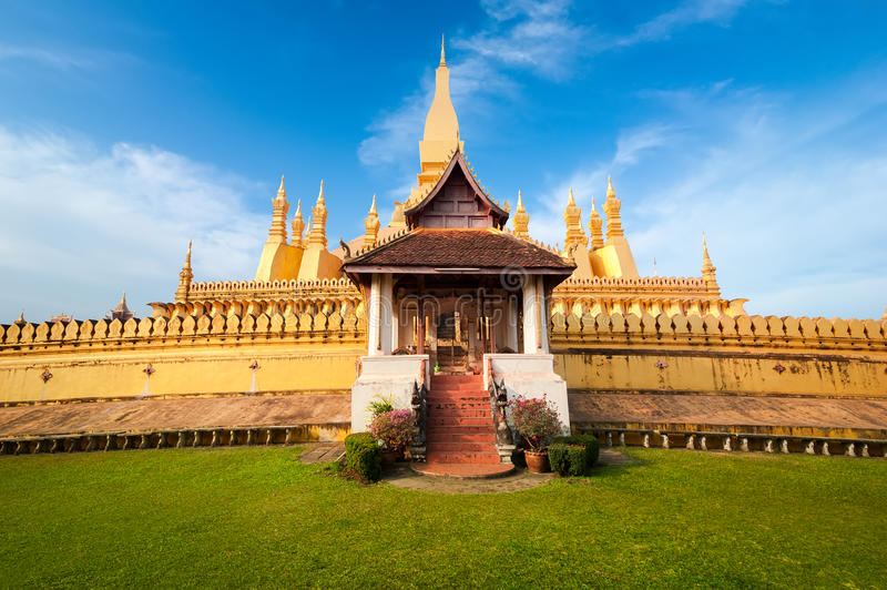 Golden buddhist pagoda of Phra That Luang Temple. Vientiane, Laos. Religious architecture and landmarks. Golden buddhist pagoda of Phra That Luang Temple under royalty free stock image