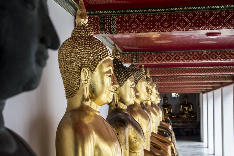 Buddhist statues in the Wat Pho temple in Bangkok royalty free stock photos
