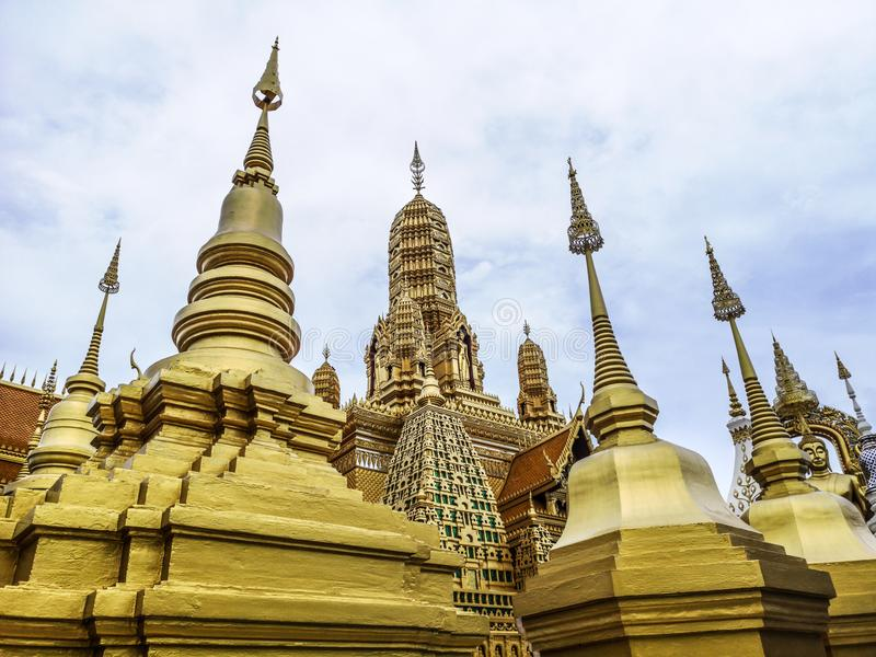 Golden buddhist temple with stupa, replica of an ancient thai temple in Ancient City at Muang Boran in Thailand. Buddhavas of the Substanceless Universe royalty free stock photography