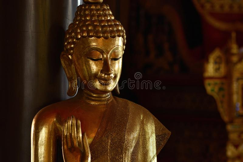 Golden of buddish state in the art style ,Wat Krathum Suea Pla t stock image