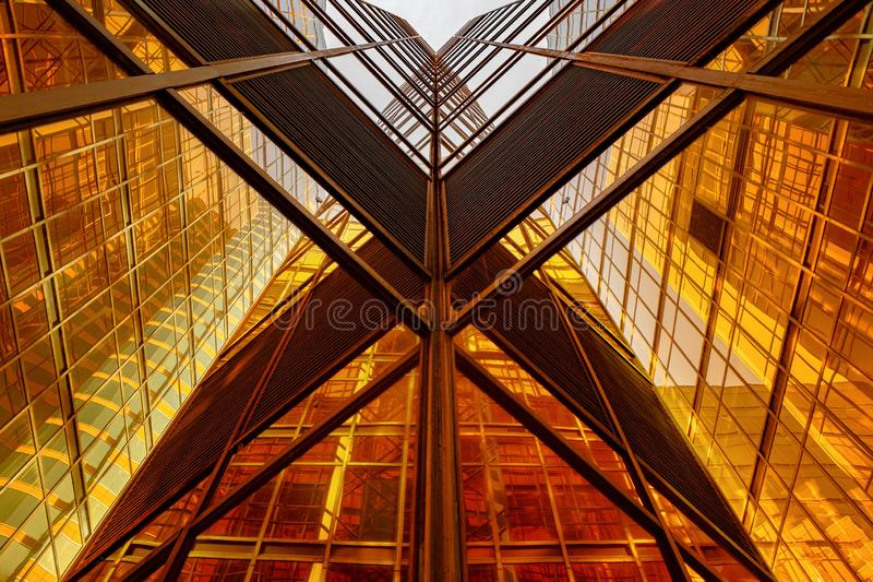 Golden building. Windows glass of modern office skyscrapers in technology and business concept. Facade design. Construction royalty free stock photo
