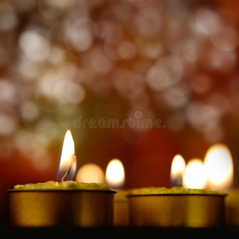 Golden Burning Candles Royalty Free Stock Photos